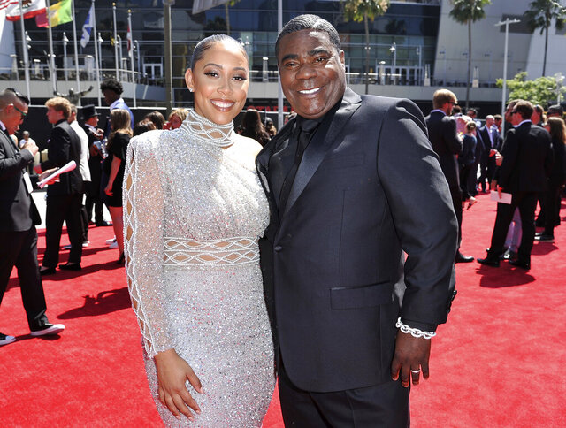FILE - Megan Wollover, left, and Tracy Morgan arrive at the ESPY Awards on July 10, 2019, in Los Angeles. Morgan and his wife of five years will part ways. The actor-comedian's representative said in an emailed statement Wednesday that Morgan and Wollover have filed for divorce. Morgan and Wollover married after the former