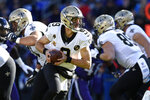 FILE - In this Oct. 21, 2018, file photo, New Orleans Saints quarterback Drew Brees drops back from the line of scrimmage during the first half of an NFL football game against the Baltimore Ravens in Baltimore. The 41-year-old Brees, who is the NFL's all-time leader in yards passing, completions and touchdowns, is entering his 20th NFL season and 15th with the Saints. (AP Photo/Gail Burton, File)