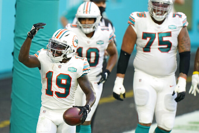 Miami Dolphins wide receiver Jakeem Grant (19) celebrates after scoring a touchdown during the first half of an NFL football game against the Los Angeles Chargers, Sunday, Nov. 15, 2020, in Miami Gardens, Fla. (AP Photo/Wilfredo Lee)