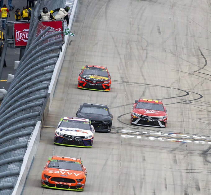 Denny Hamlin (11) wins Stage 1 of the Drydene 400 - Monster Energy NASCAR Cup Series playoff auto race, Sunday, Oct. 6, 2019, at Dover International Speedway in Dover, Del. (AP Photo/Jason Minto)