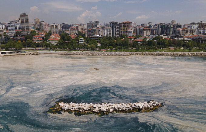 """A view of the sea, on the Caddebostan shore, on the Asian side of Istanbul, Monday, June 7, 2021. Turkey's parliament agreed on Thursday, June 10, 2021, to set up an all-party committee to investigate a mass of sea mucilage that is threatening marine life in the Sea of Marmara. The so-called """"sea snot"""" _ a thick, slimy substance made up of compounds released by marine organisms has surfaced in the sea south of Istanbul, alarming marine biologists and environmentalists. (AP Photo/Kemal Aslan)"""