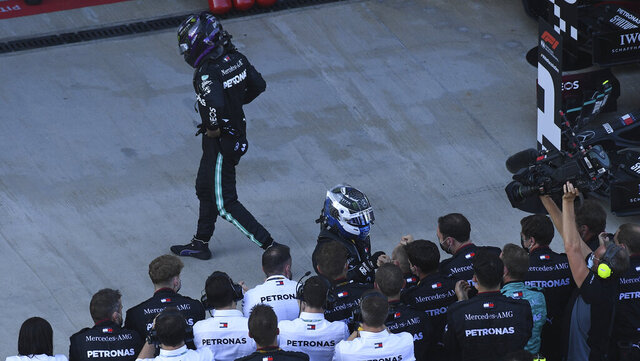 Mercedes driver Lewis Hamilton of Britain walks away after placing third in the Russian Formula One Grand Prix, at the Sochi Autodrom circuit, in Sochi, Russia, Sunday, Sept. 27, 2020. (Kirill Kudryavtsev, Pool via AP)