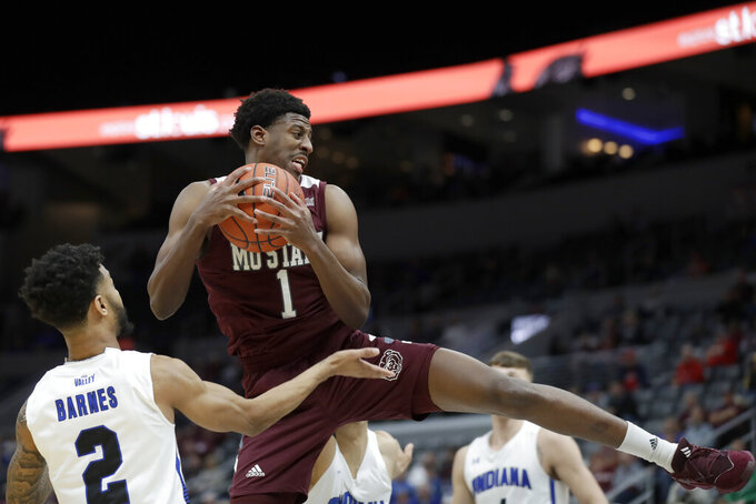 Missouri State's Keandre Cook (1) grabs a rebound as Indiana State's Jordan Barnes (2) watches during the second half of an NCAA college basketball game in the quarterfinal round of the Missouri Valley Conference men's tournament Friday, March 6, 2020, in St. Louis. (AP Photo/Jeff Roberson)