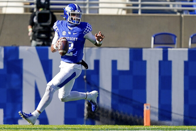 Kentucky quarterback Joey Gatewood (2) scrambles with the ball during the second half of an NCAA college football game against Georgia, Saturday, Oct. 31, 2020, in Lexington, Ky. (AP Photo/Bryan Woolston)