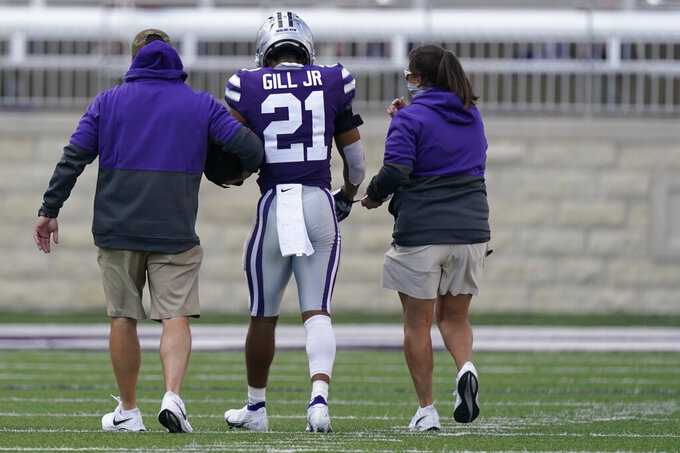 Kansas State wide receiver Wykeen Gill (21) is led off the field after an injury during the second half of the team's NCAA college football game against Texas Tech on Saturday, Oct. 3, 2020, in Manhattan, Kan. (AP Photo/Charlie Riedel)
