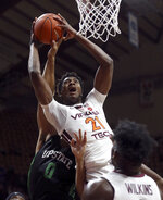 CORRECTS TECH PLAYER TO JOHN OJIAKO, INSTEAD OF KEVIN ALUMA - Virginia Tech's John Ojiako grabs a rebound next to South Carolina-Upstate's Brandon Martin (0) during the first half of an NCAA college basketball game Wednesday, Nov. 13, 2019, in Blacksburg, Va. (Matt Gentry/The Roanoke Times via AP)
