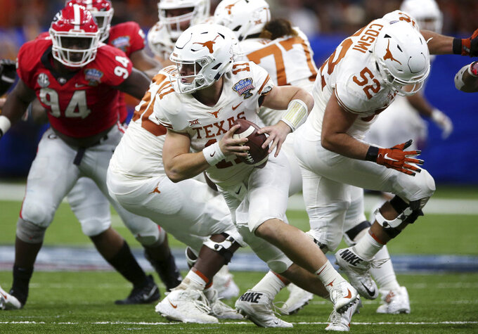 Texas quarterback Sam Ehlinger (11) scrambles during the first half of the Sugar Bowl NCAA college football game against Georgia in New Orleans, Tuesday, Jan. 1, 2019. (AP Photo/Rusty Costanza)