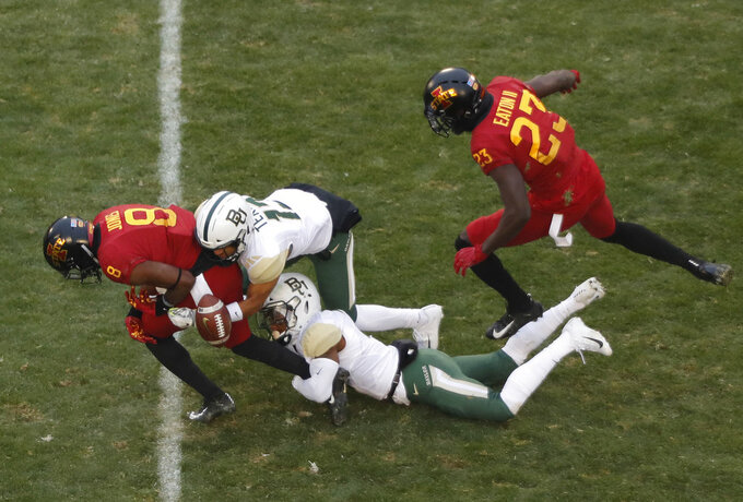 Baylor cornerback Raleigh Texada, center, and Baylor safety Chris Miller, bottom rips the ball away from Iowa State wide receiver Deshaunte Jones, left, during the first half of an NCAA college football game, Saturday, Nov. 10, 2018, in Ames. (AP Photo/Matthew Putney)