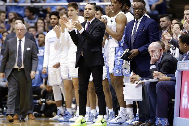 North Carolina guard Cole Anthony (2) reacts from the sidelines with an injury during the first half of an NCAA college basketball game against Yale in Chapel Hill, N.C., Monday, Dec. 30, 2019. (AP Photo/Gerry Broome)
