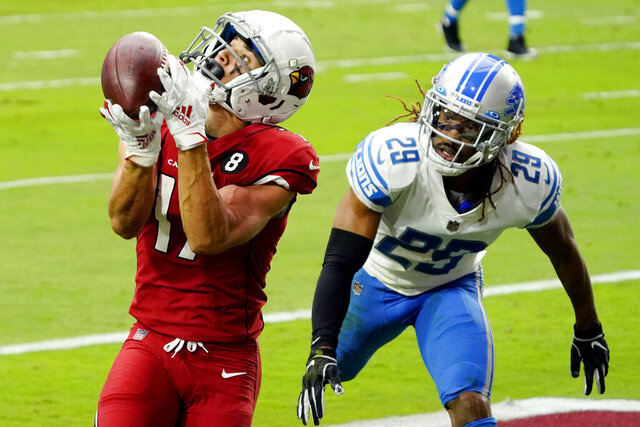 Arizona Cardinals wide receiver Andy Isabella pulls in a touchdown pass as Detroit Lions cornerback Darryl Roberts (29) defends during the first half of an NFL football game, Sunday, Sept. 27, 2020, in Glendale, Ariz. (AP Photo/Rick Scuteri)