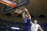 TCU forward Vladimir Brodziansky (10) dunks while being defended by West Virginia forward Logan Routt (31) during the first half of an NCAA college basketball game Monday, Feb. 12, 2018, in Morgantown, W.Va. (AP Photo/Raymond Thompson)