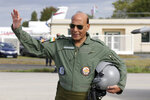 Indian Defense Minister Rajnath Singh gestures before a test flight in a Rafale jet fighter at the Dassault Aviation plant in Merignac, near Bordeaux, southwestern France, Tuesday, Oct. 8, 2019. France has delivered to India its first Rafale fighter jet from a series of 36 aircraft purchased in a multi-billion dollar deal in 2016. (AP Photo/Bob Edme)