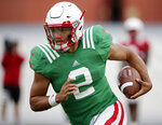 Nebraska quarterback Adrian Martinez (2) runs with the ball during NCAA college football fall practice in Lincoln, Neb., Wednesday, Aug. 8, 2018. Nebraska's three-man quarterback race remains too close to call. Quarterbacks coach Mario Verduzco says Adrian Martinez, Tristan Gebbia and Andrew Bunch continue to get an equal number of snaps with the first-string offense. (AP Photo/Nati Harnik)