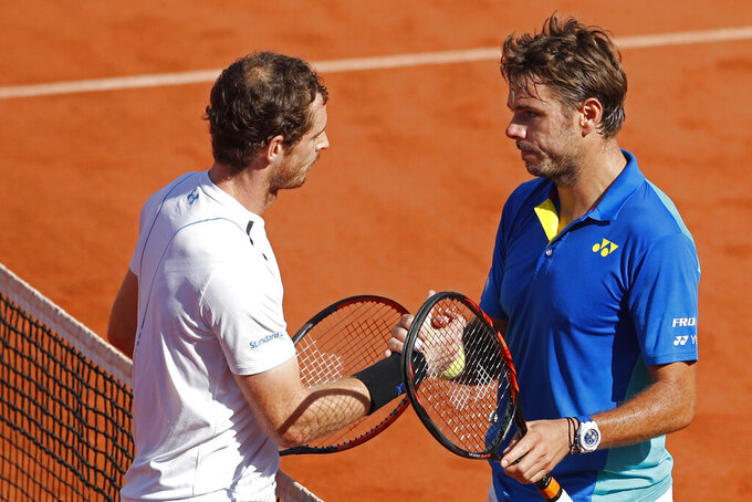 FILE - In this June 9, 2017, file photo, Britain's Andy Murray, left, congratulates Switzerland's Stan Wawrinka with his semifinal win at the French Open tennis tournament at the Roland Garros stadium, in Paris, France. The most-anticipated matchup on Day 1 in the main stadium will be Andy Murray vs. Stan Wawrinka in a contest between two men with three Grand Slam titles apiece. (AP Photo/Petr David Josek, File)