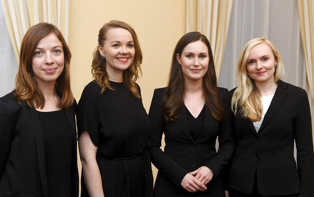 The new Prime Minister of Finland Sanna Marin, 2nd right, with Minister of Education Li Andersson, left, Minister of Finance Katri Kulmuni, 2nd left, and Minister of Interior Maria Ohisalo, right, after the first meeting of the new government in Helsinki, Finland on Tuesday, Dec. 10, 2019.  Finland's parliament chose Sanna Marin as the country's new prime minister Tuesday, making the 34-year-old the world's youngest sitting head of government. (Heikki Saukkomaa/Lehtikuva via AP)