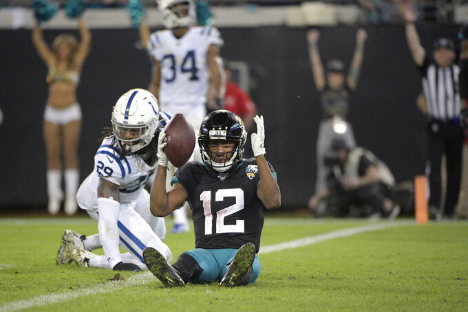 FILE - In this Sunday, Dec. 29, 2019, file photo, Jacksonville Jaguars wide receiver Dede Westbrook (12) celebrates after catching an 18-yard pass in the end zone for a touchdown in front of Indianapolis Colts safety Malik Hooker (29) during the second half of an NFL football game in Jacksonville, Fla. The Minnesota Vikings have signed former Jacksonville wide receiver Westbrook. He brings some needed depth at the position and another option for a punt returner. (AP Photo/Phelan M. Ebenhack, File)