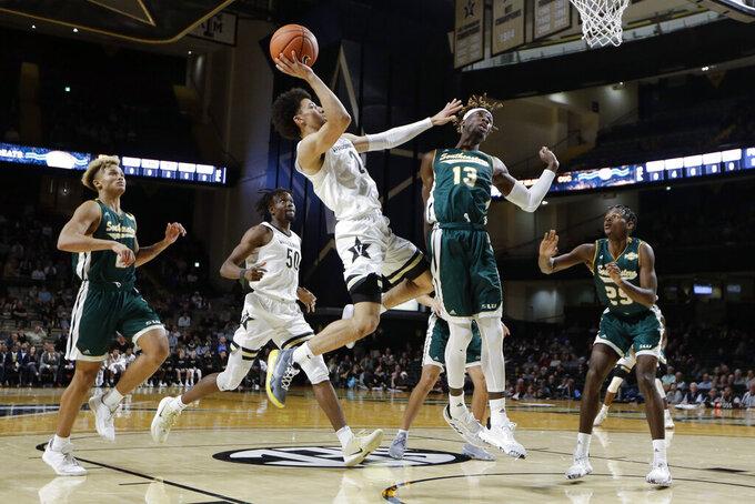 Vanderbilt guard Scotty Pippen Jr. (2) shoots against Southeastern Louisiana forward Pape Diop (13) in the first half of an NCAA college basketball game Monday, Nov. 25, 2019, in Nashville, Tenn. (AP Photo/Mark Humphrey)