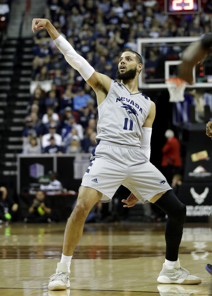 Nevada's Cody Martin watches after his shot during the first half of an NCAA college basketball game against San Diego State in the Mountain West Conference men's tournament Friday, March 15, 2019, in Las Vegas. (AP Photo/Isaac Brekken)