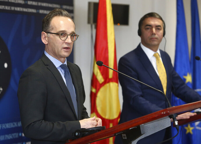 German Foreign Minister Heiko Maas, left, talks for the media during a news conference with his North Macedonia's counterpart Nikola Dimitrov, right, after their meeting in Skopje, North Macedonia, on Wednesday, Nov. 13, 2019. Maas arrived Wednesday in Skopje to discuss with his counterpart Nikola Dimitrov the bilateral relations and the further steps after North Macedonia has failed to open the membership talks with European Union last month. (AP Photo/Boris Grdanoski)