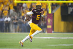 Arizona State quarterback Jayden Daniels scrambles for a first down against Kent State during the first half of an NCAA college football game Thursday, Aug. 29, 2019, in Tempe, Ariz. (AP Photo/Ralph Freso)