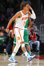 Atlanta Hawks guard Trae Young (11) reacts after scoring in the first half of an NBA basketball game against the Boston Celtics on Monday, Feb. 3, 2020, in Atlanta. (AP Photo/Todd Kirkland)