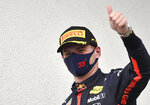 Second placed Red Bull driver Max Verstappen of the Netherlands celebrates after the Hungarian Formula One Grand Prix at the Hungaroring racetrack in Mogyorod, Hungary, Sunday, July 19, 2020. (Joe Klamar/Pool via AP)