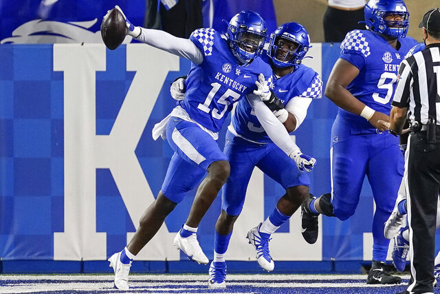Kentucky linebacker Jordan Wright (15) celebrates after scoring a touchdown during the second half of the team's NCAA college football game against Mississippi State, Saturday, Oct. 10, 2020, in Lexington, Ky. (AP Photo/Bryan Woolston)