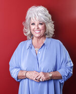 FILE - In this Jan. 17, 2012 file photo, celebrity chef Paula Deen poses for a portrait in New York. Two of Paula Deen's Family Kitchen locations have closed in the Florida Panhandle. Paula Deen Ventures spokesman Jaret Keller confirmed Tuesday, Nov. 12, 2019, that licensing partner Phoenix Hospitality has decided to close its Destin and Panama City Beach restaurants.  (AP Photo/Carlo Allegri, File)