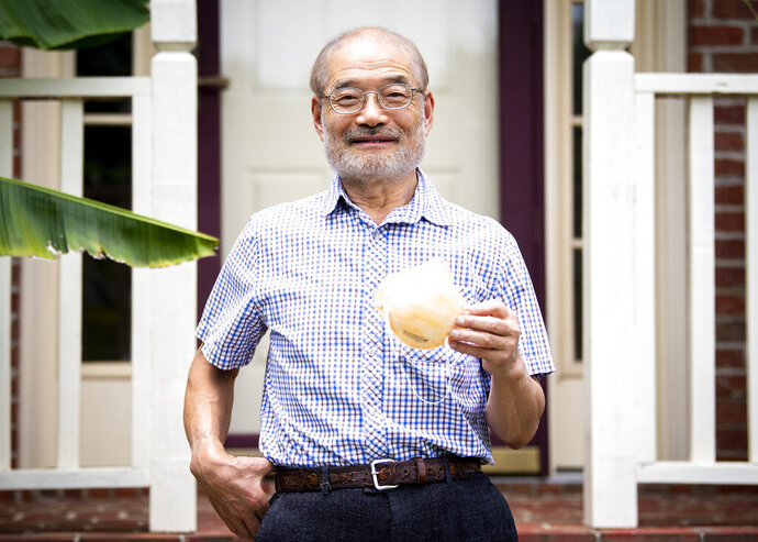 This June 3, 2020 photo shows Peter Tsai, the inventor of the N95 filtration material, at his Knoxville, Tenn., home.  Since mid-March, Tsai has been a worldwide force on two fronts — finding new ways to sterilize disposable respirators for reuse and rapidly scaling up their production.  (Brianna Paciorka/Knoxville News Sentinel via AP)