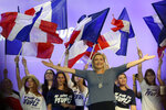 FILE - In this Sunday, Sep. 18, 2016 file photo, far-right National Front president Marine Le Pen, waves to supporters during a meeting in Frejus, southern France. She re-branded her father's far-right National Front party as the National Rally after losing the presidency to Emmanuel Macron in 2017. Despite the loss, she made important inroads among young French voters over her previous attempt in 2012, easily outstripping all the traditional parties in polling among the young as well as the far-left candidate. (AP Photo/Claude Paris)