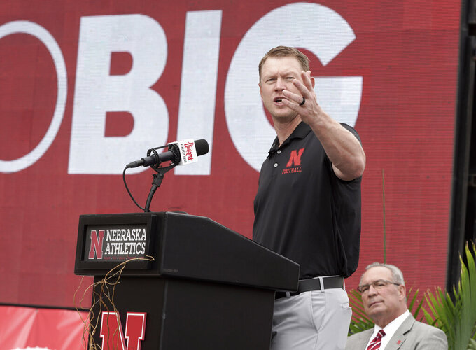 Nebraska Athletic Director Bill Moos, right, listens as football coach Scott Frost speaks during an NCAA college football news conference, Friday, Sept. 27, 2019, in Lincoln, Neb., announcing a new planned $150 million football training facility adjacent to Memorial Stadium. (AP Photo/Nati Harnik)