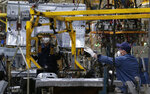 Workers assemble the BAIC Jeep chassis frames at the Chinese automaker BAIC ORU assembly plant in Beijing, Wednesday, Aug. 29, 2018. Their tariff war with the U.S. grabs headlines, but China faces bigger economic challenges than U.S. President Donald Trump. Communist leaders who are trying to nurture more sustainable growth in the world's No. 2 economy clamped down on bank lending to rein in surging debt. (AP Photo/Andy Wong)