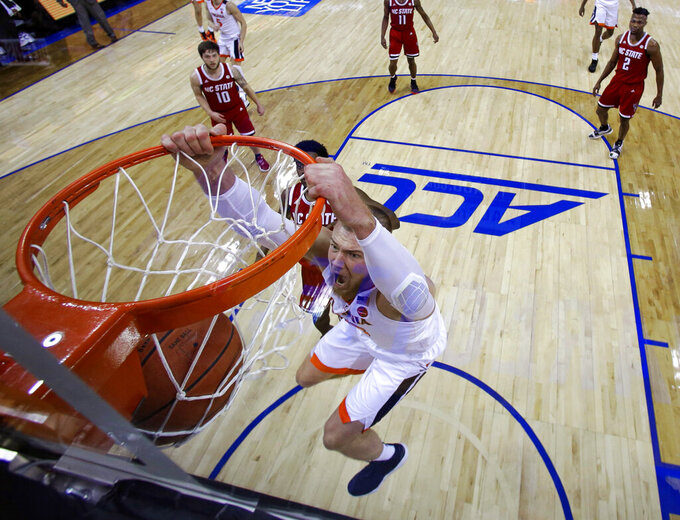 Virginia's Jack Salt (33) dunks against North Carolina State during the first half of an NCAA college basketball game in the Atlantic Coast Conference tournament in Charlotte, N.C., Thursday, March 14, 2019. (AP Photo/Chuck Burton)