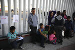 Central American migrants wait to see if their number will be called to cross the border and apply for asylum in the United States, at the El Chaparral border crossing in Tijuana, Mexico, Friday, Sept. 13, 2019. Dozens of immigrants lined up Friday at a major Tijuana border crossing waiting to learn how the Trump administration's radical new restrictions on who qualifies for asylum would affect the tens of thousands of migrants stuck on the Mexican border seeking refuge.(AP Photo/Emilio Espejel)