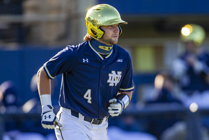 FILE - Notre Dame's Carter Putz is shown during an NCAA baseball game against Florida State in South Bend, Ind., Friday, May 7, 2021. Automatic bids for the NCAA Tournament are on the line as conference tournaments begin in earnest this week. Notre Dame is the top seed in the Atlantic Coast Conference. (AP Photo/Robert Franklin, File)