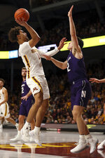 Minnesota's Tre' Williams shoots the ball over Northwestern's Ryan Greer during an NCAA college basketball game Sunday, Jan. 5, 2020, in Minneapolis. (AP Photo/Stacy Bengs)