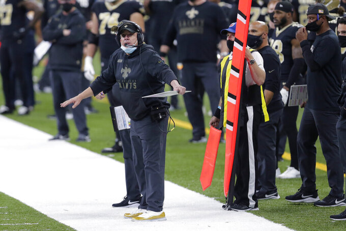 FILE - In this Sunday, Nov. 22, 2020 file photo, New Orleans Saints head coach Sean Payton reacts on the sideline in the first half of an NFL football game against the Atlanta Falcons in New Orleans. The NFL has fined the New Orleans Saints $500,000 and stripped them of a 2021 seventh-round draft pick for violating league COVID-19 protocols, a person with direct knowledge of the discipline told The Associated Press on Sunday, Nov. 29. New Orleans was fined as a repeat offender; Payton previously was docked $150,000 and the team $250,000 because the head coach failed to properly wear a face covering against the Raiders in Week 2.   (AP Photo/Brett Duke, File)