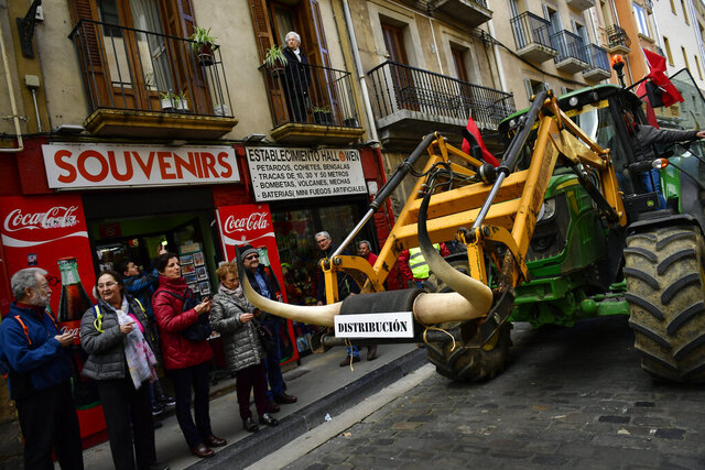 A farmer blocks the center of the city with his tractors during a protest in Pamplona, northern Spain, Wednesday, Feb. 19, 2020. Farmers across Spain are taking part in mass protests over what they say are plummeting incomes for agricultural workers. (AP Photo/Alvaro Barrientos)