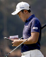 Takumi Kanaya of Japan checks his scorecard after playing the 16th hole during the opening round of the Australian Open Golf tournament in Sydney, Thursday, Dec. 5, 2019. (AP Photo/Rick Rycroft)