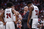 Louisville head coach Chris Mack talks to his players during the second half of an NCAA college basketball game against Syracuse Wednesday, Feb. 19, 2020, in Louisville, Ky. Louisville won 90-66. (AP Photo/Wade Payne)
