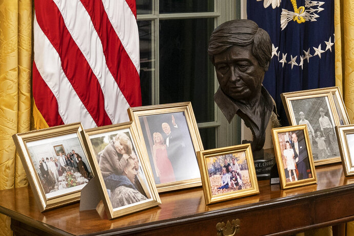 FILE - This Wednesday, Jan. 20, 2021, file photo shows the newly redecorated Oval Office of the White House in Washington. Paul Chavez had no idea where a sculpture of his father, Latino American civil rights and labor leader Cesar Chavez, would end up in the White House. He agreed just this week to lend the bronze bust to President Joe Biden and hustled to get it wrapped up and shipped across the country from California. It was an utter surprise Wednesday when he saw Biden at his desk in the Oval Office, with the bust of the late Cesar Chavez right behind the president. (AP Photo/Alex Brandon, File)