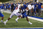 Tulsa running back T.K. Wilkerson (21) is knocked out of bounds short of the goal line by SMU safety Chace Cromartie (18) during the second half of an NCAA college football game in Tulsa, Okla., Saturday, Nov. 14, 2020. (AP Photo/Joey Johnson)