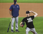 Atlanta Braves manager Brian Snitker looks on while game 1 starting pitcher Max Fried throws from the mound during the team workout for the best-of-seven National League Championship Series against the Dodgers at Globe Life Field on Sunday, Oct 11, 2020 in Arlington. (Curtis Compton/Atlanta Journal-Constitution via AP)