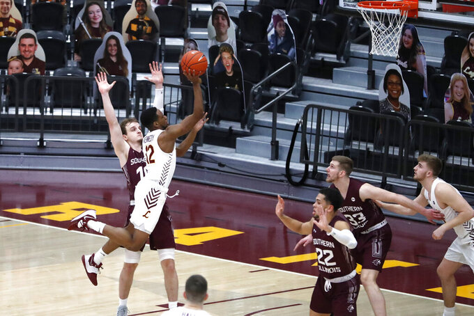 Loyola Chicago guard Marquise Kennedy (12) drives to the basket as Southern Illinois' Ben Harvey defends during the first half of an NCAA college basketball game Friday, Feb. 26, 2021, in Chicago. (AP Photo/Shafkat Anowar)