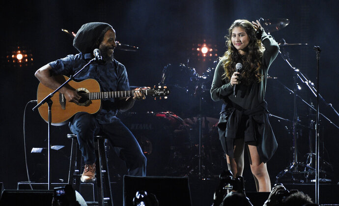 FILE - This Jan. 16, 2019 file photo shows Toni Cornell, right, daughter of the late singer Chris Cornell, performing with Ziggy Marley during