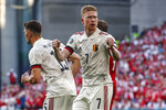Belgium's Kevin De Bruyne reacts after Thorgan Hazard scored during the Euro 2020 soccer championship group B match between Denmark and Belgium, at the Parken stadium in Copenhagen, Thursday, June 17, 2021. (Wolfgang Rattay, Pool via AP)