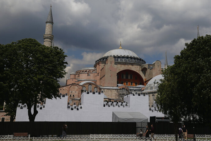 A view of a ''wall' set in front of Istanbul's 6th-century Hagia Sophia, the main cathedral of the Byzantine Empire which was converted into a mosque with the Ottoman conquest of the city, then known as Constantinople, in 1453, that was to be used as a set for the celebrations to mark the 567th anniversary of the conquest in Istanbul, Friday, May 29, 2020.  A Muslim cleric recited the