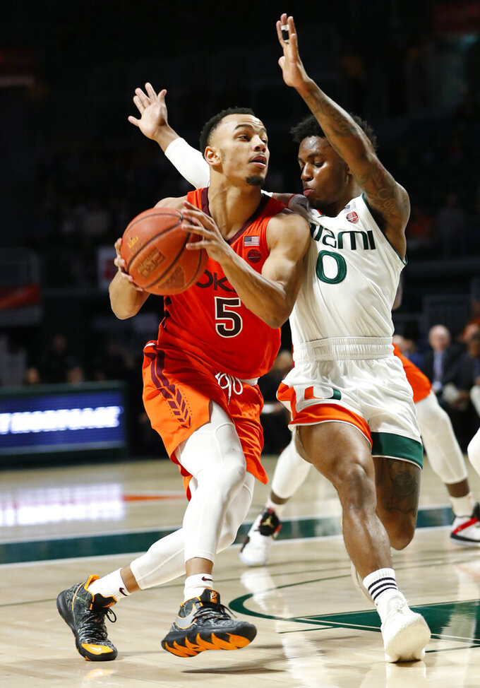 Virginia Tech guard Justin Robinson (5) drives to the basket against Miami guard Chris Lykes (0) during the second half of an NCAA college basketball game, Wednesday, Jan. 30, 2019, in Coral Gables, Fla.(AP Photo/Wilfredo Lee)