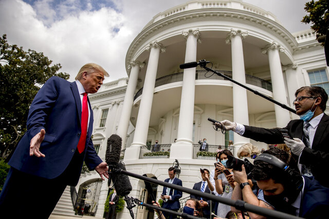 President Donald Trump speaks with members of the media before boarding Marine One on the South Lawn of the White House in Washington, Thursday, Aug. 6, 2020, for a short trip to Andrews Air Force Base, Md. and then on to Cleveland, Ohio. (AP Photo/Andrew Harnik)