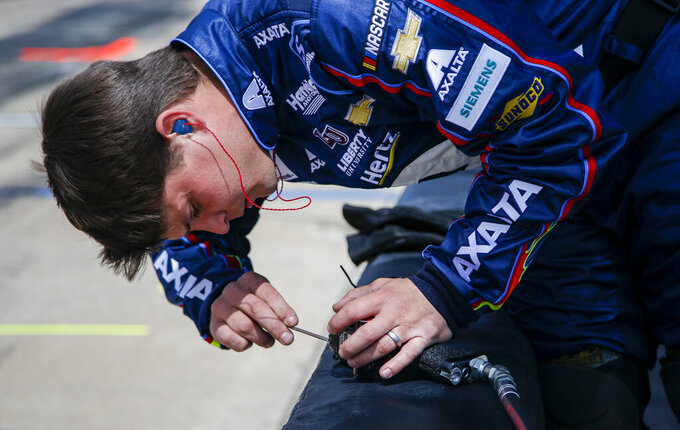 A member of William Byron's pit crew adjusts his impact air wrench before a NASCAR Cup auto race at Texas Motor Speedway, Sunday, March 31, 2019, in Fort Worth, Texas. (AP Photo/Brandon Wade)